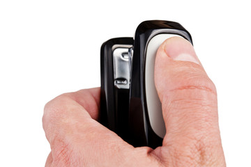 Hand holding black stapler, isolated on white