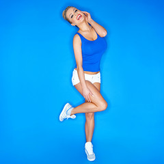 Happy Young Woman Wearing Canvas Shoes