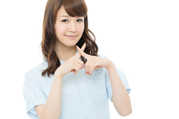 Beautiful young nurse on white background