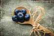 Blueberries on a Spoon with Burlap Woven Background
