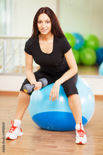 Woman in a gym on a ball