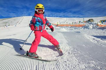 Girl with ski on the mountain