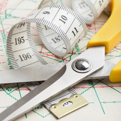 scissors and measuring tape on sewing pattern