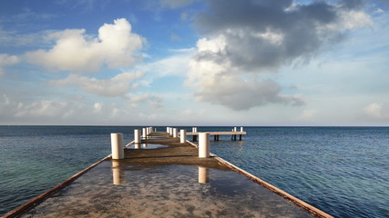Morning pier stretching into the horizon of the Caribbean