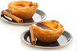 Custard Pies with cinnamon sticks