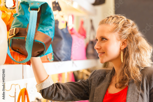 Woman buying a bag in mall