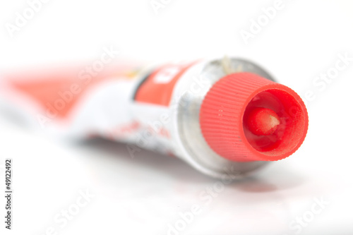 red tube of cream. macro