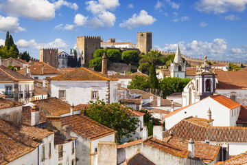 Roofs and castle of Obidos, a medieval town in Portugal