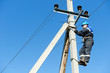 power electrician lineman at work on pole - 49123250