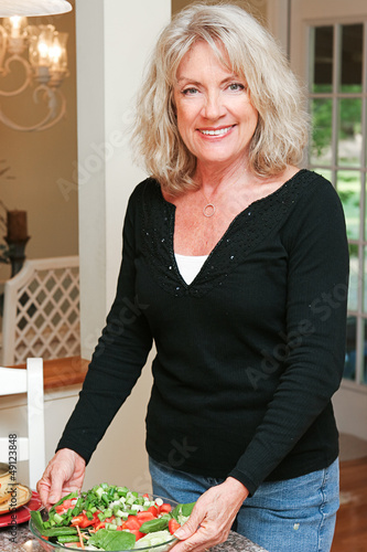 Healthy Mature Woman with Salad