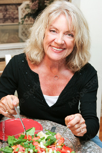 Healthy Middle-aged Woman Eating Salad