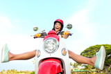 Funny happy free woman on scooter