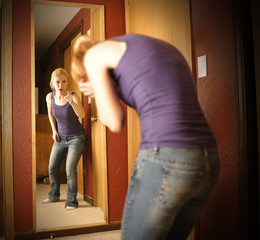 Sad Angry Woman in Mirror
