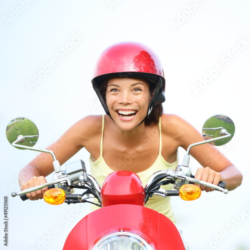 Excited woman on scooter happy