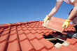 Leinwanddruck Bild - Construction worker tile roofing repair