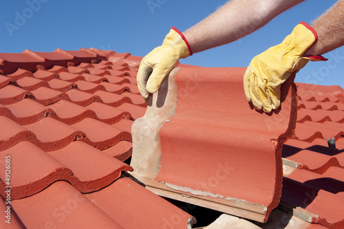 Construction worker tile house roofing repair