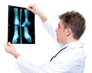 attractive and expressive doctor holding x-ray