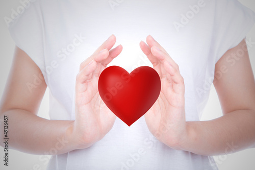 Heart on woman hands over body