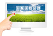 Hand pushing Minimum word on monitor screen.