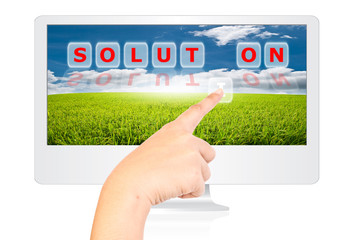 Hand pushing Solution word on monitor screen.