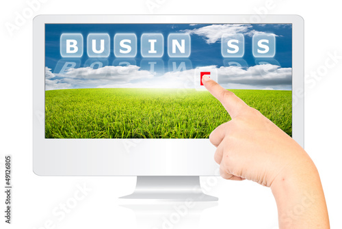 Hand pushing Business word on monitor screen.