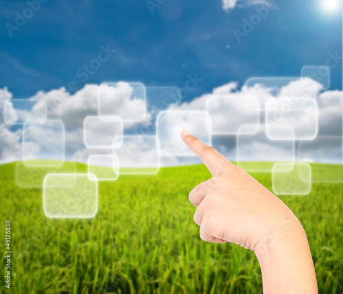Business lady hand pushing button on the blue sky field.