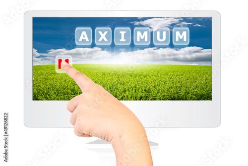 Hand pushing Maximum word on monitor screen.