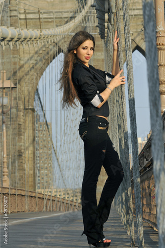 Fashion model posing pretty on Brooklyn Bridge in New York