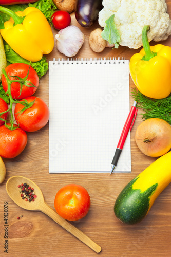 Organic Vegetables on Wooden Table and Notebook