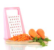 carrots with grater on cutting board isolated on white