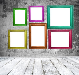 Empty room with multicolored photo frames