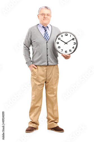 Full length portrait of a gentleman holding a wall clock