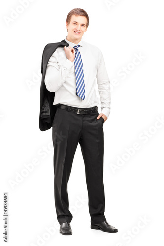 Full length portrait of a young businessman posing with a coat o