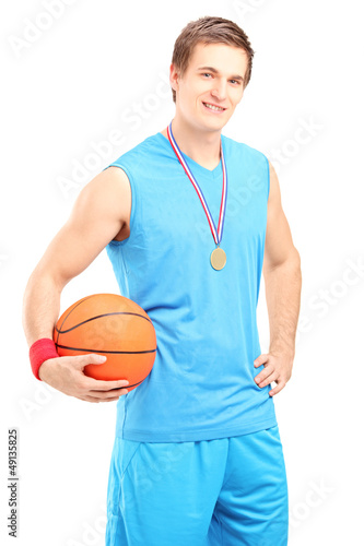 Winner basketball player posing with a golden medal