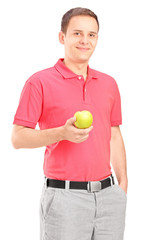 Young man posing with an apple in his hand