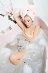 Woman blonde in a bath  with foam