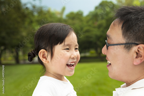 happy asian little girl with her father