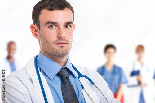 Doctor in front of his medical team