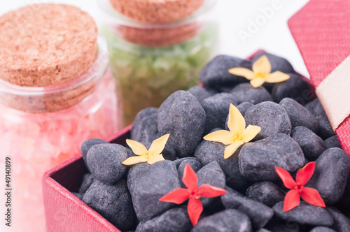 Spa concept with black zen stones and bath salts closeup