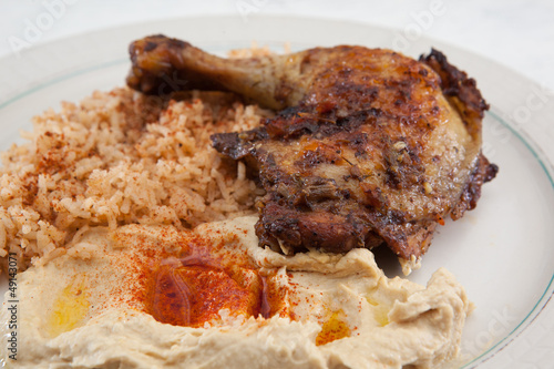 Dinner of saffron rice, roasted chicken and hummus