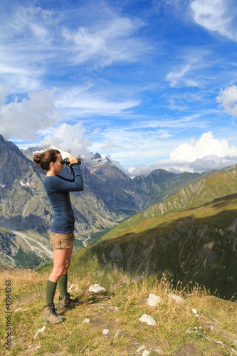 Young girl on top of Ferret Valley with binocular