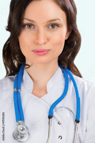 Closeup portrait of adult female doctor with kind look at hospit