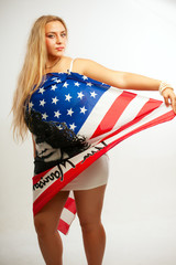 Pretty young woman with american flag