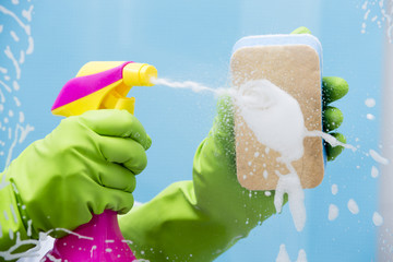 Cleaning - cleaning window pane with spray detergent