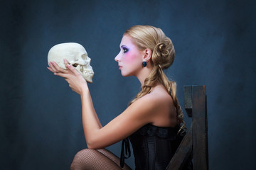 Woman with a skull, studio shot