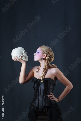 Blonde with a skull, studio shot