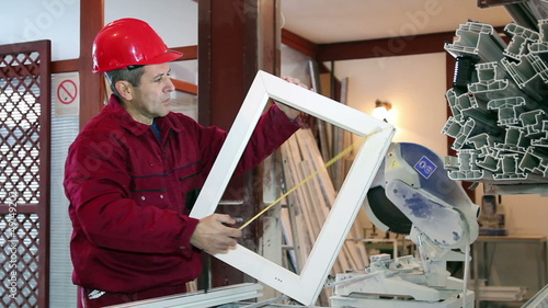 Worker Measuring Window Frame
