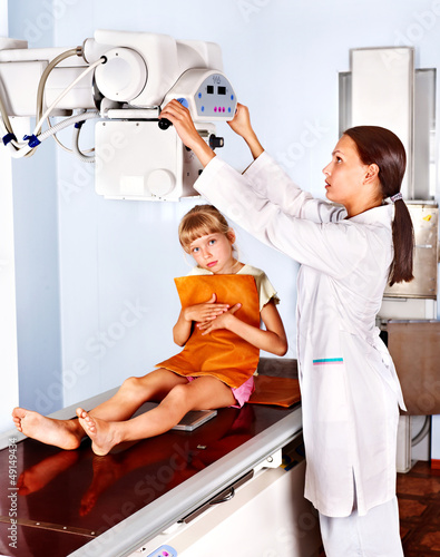 Little girl with doctor radiologist.