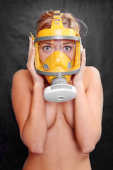 Terrified woman in a yellow gas mask.