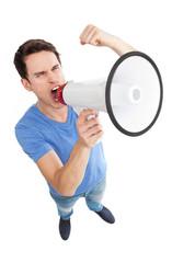 Young man shouting through megaphone